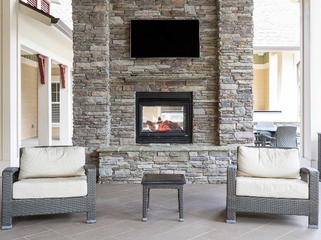 Outdoor Fireplace Lounge Area with TV