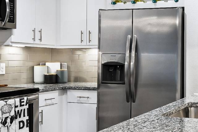 Granite Countertops + Designer Backsplash