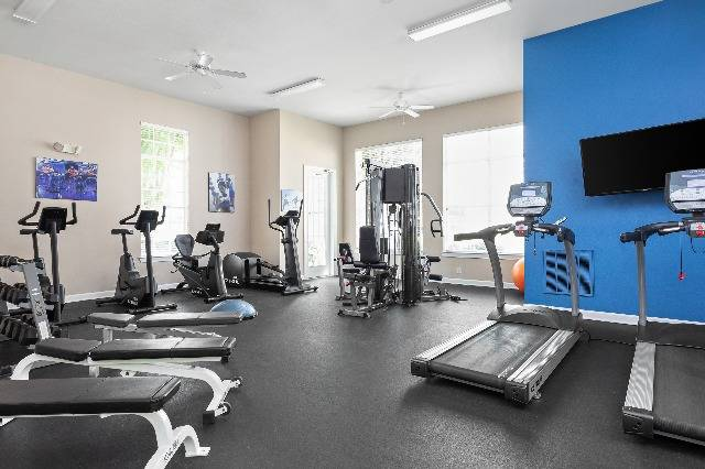 Fitness Center with Cardio, Free Weights, and Televisions