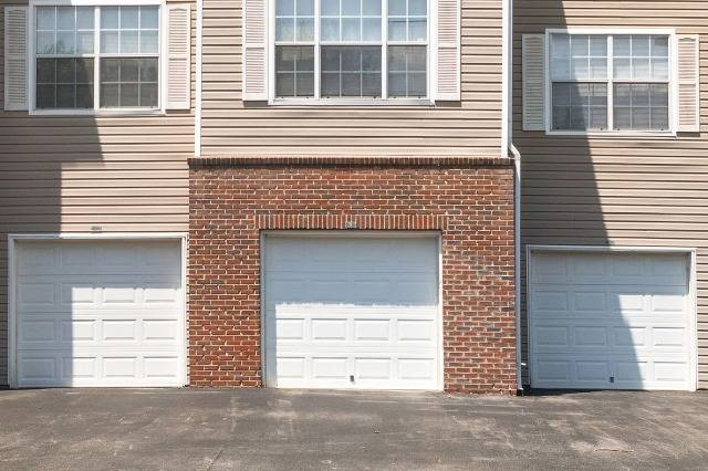 Attached Garages with White Doors