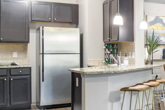 Chef Kitchen with Pendant Lighting and Designer Tile Backsplash