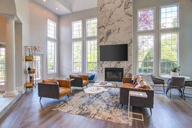 Brand New Community Clubhouse and Lounge with Fireplace, Large Windows, and Seating Area