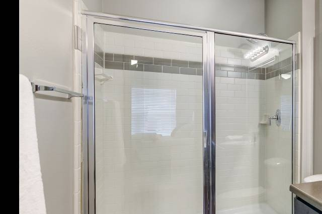 Glass Enclosed Shower with Subway Tile and Rain Shower Head
