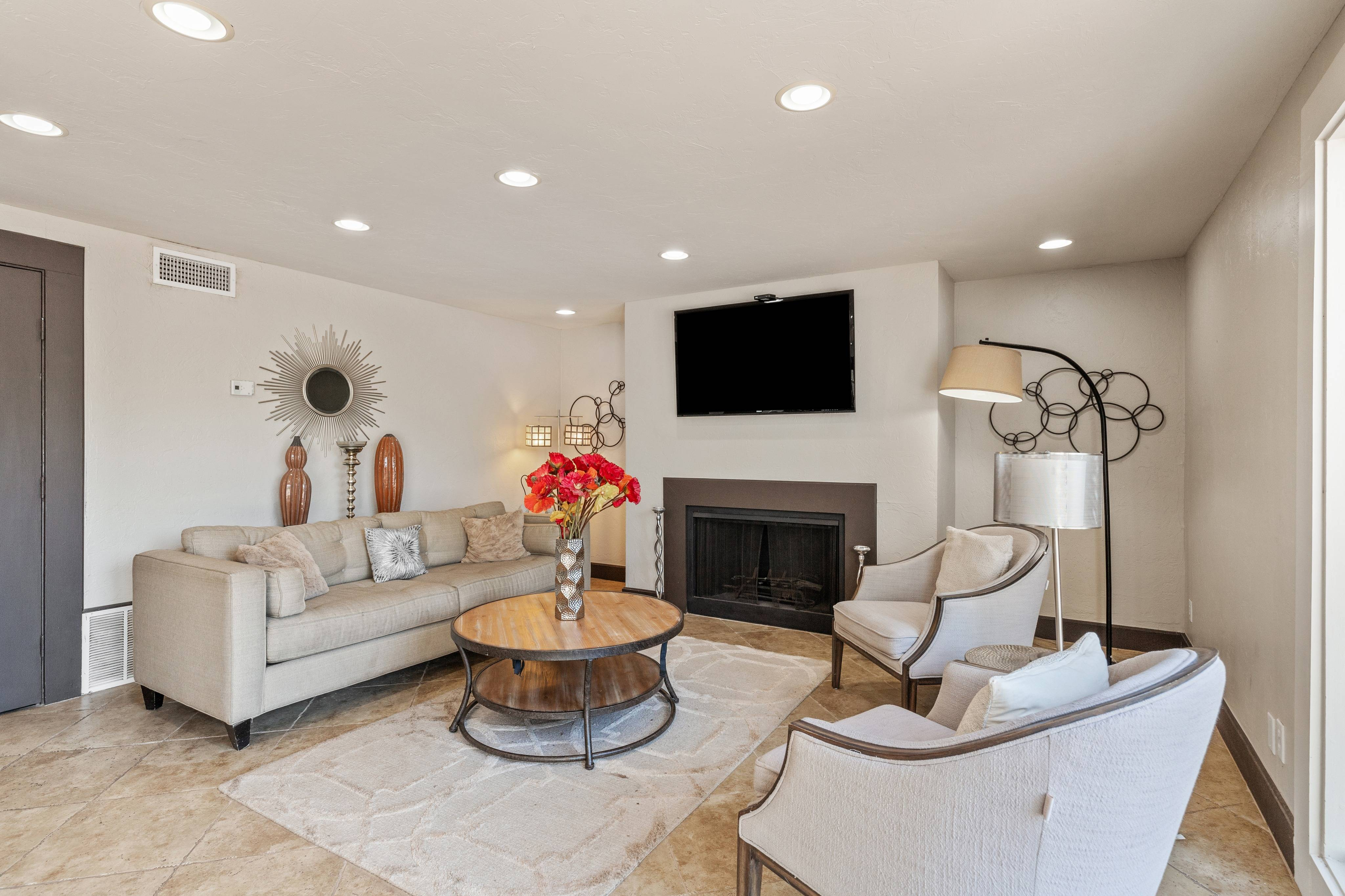 Community Clubhouse Seating Area with Fireplace and TV