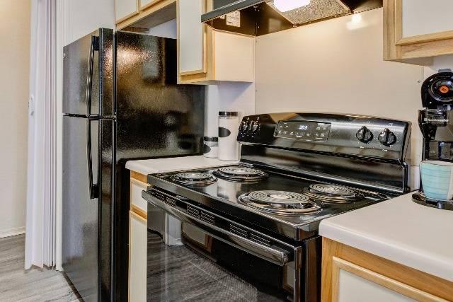 Upgraded Black Appliances in Kitchen
