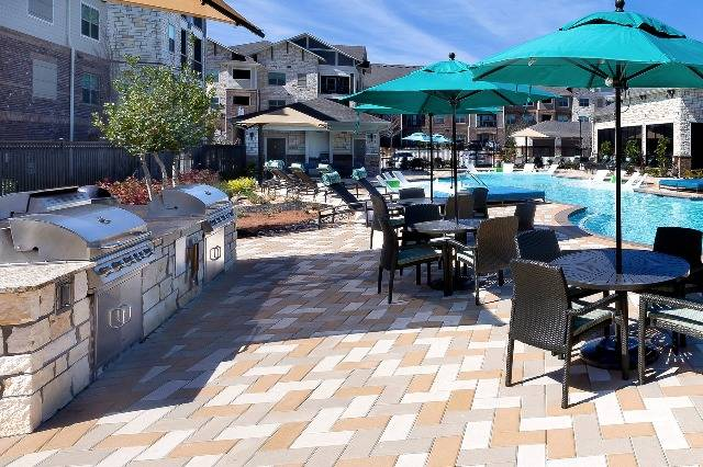 Poolside Community Grilling Area with Picnic Tables