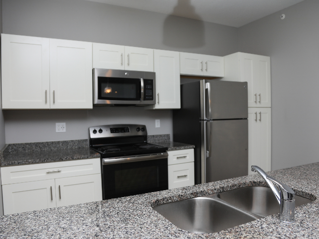 Gray-White Kitchen with gray, white, and black speckled granite counter tops
