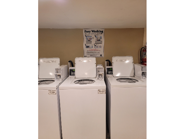 picture of three white coin operated wash machines