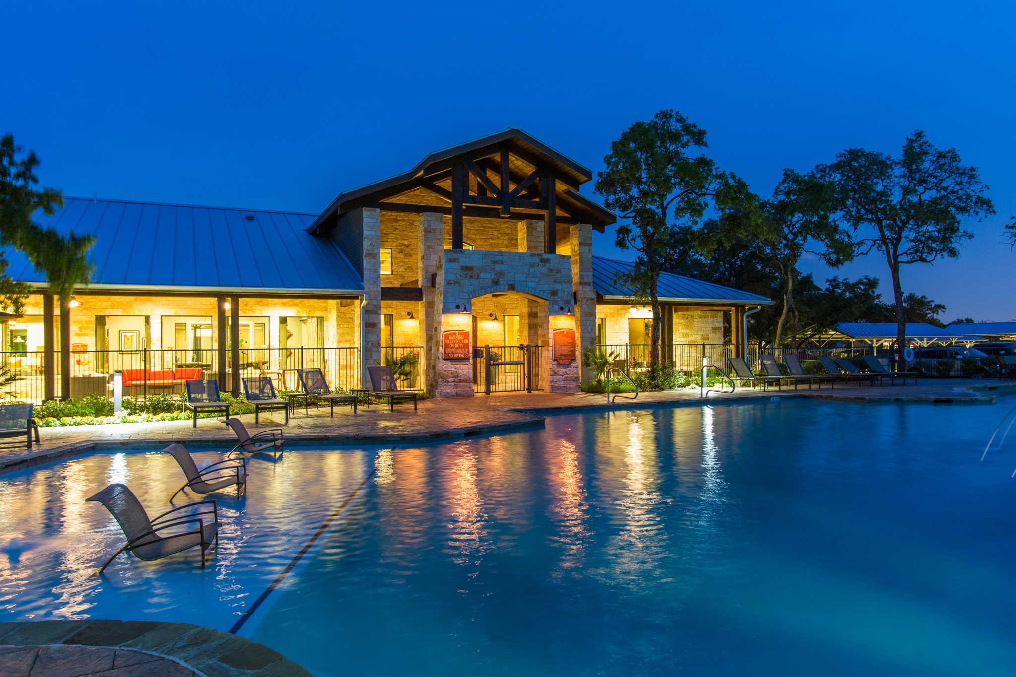 Evening Pool with back lit Clubhouse