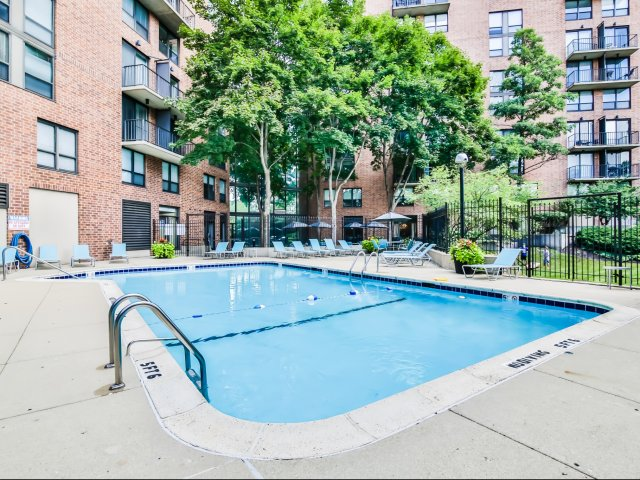 Residents Lounging by the Pool | Arlington Heights IL Apartments For Rent | Hancock Square at Arlington Station