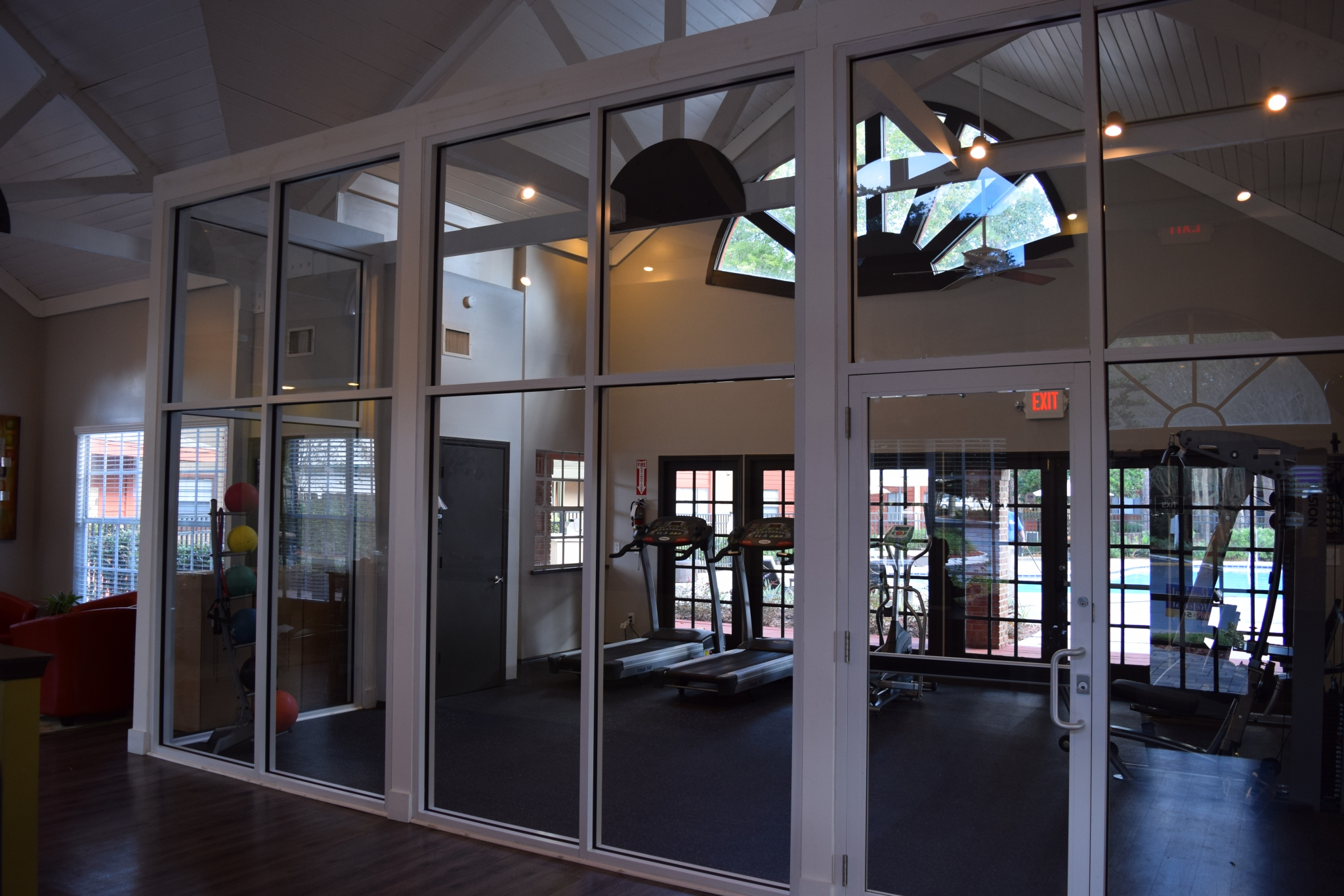 Deerfield Apartments view of community fitness center with treadmills and medicine balls