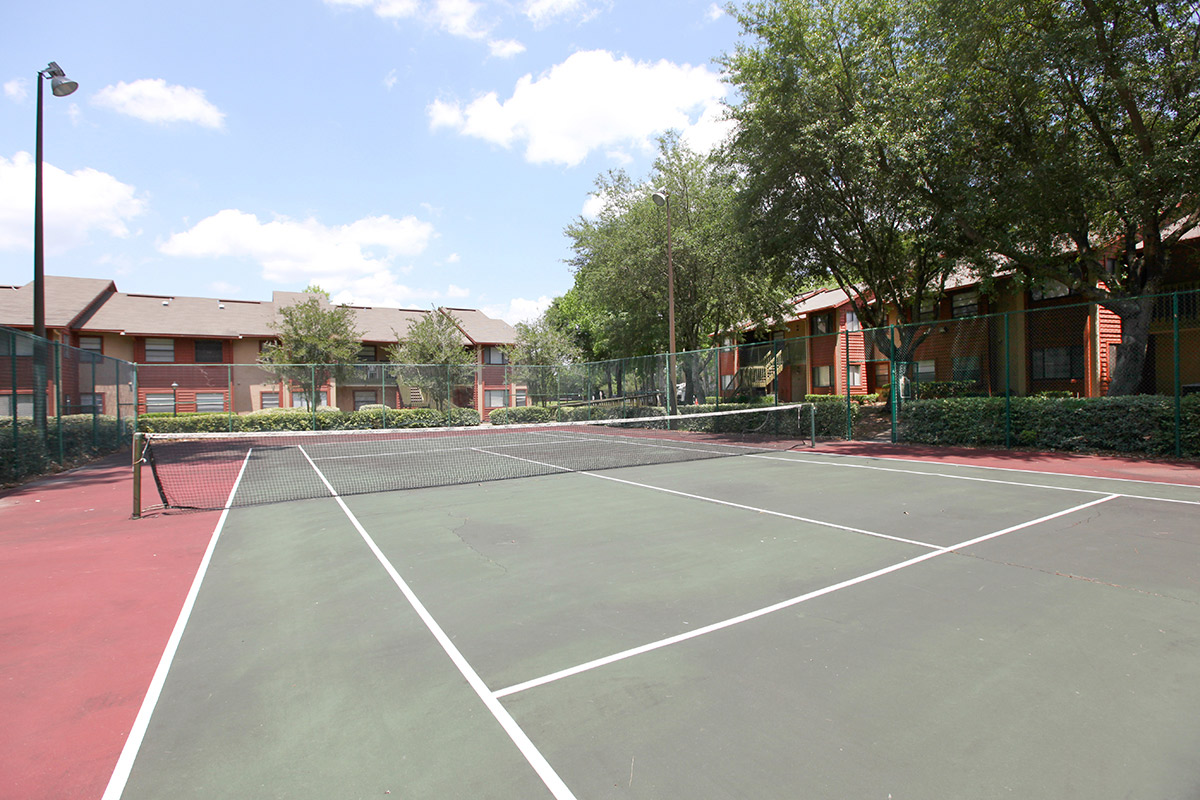 Deerfield Apartments outdoor tennis court on site