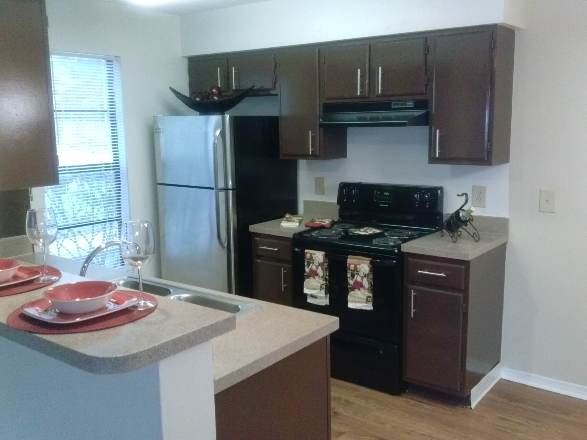 Deerfield Apartments upgraded kitchen with espresso cabinetry and new appliances