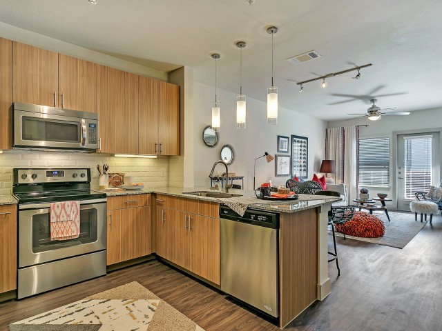 Residents Cooking in the Kitchen   Apartments Homes for rent in Dallas, TX   Alexan West Dallas