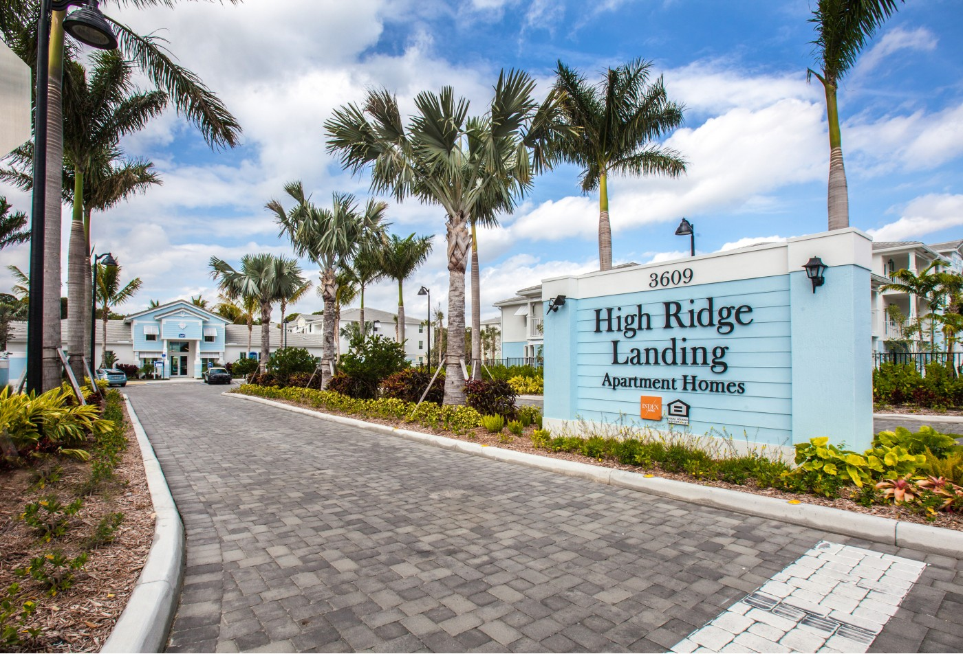 Residents Lounging by the Pool | Boynton Beach FL Apartments For Rent | High Ridge Landing