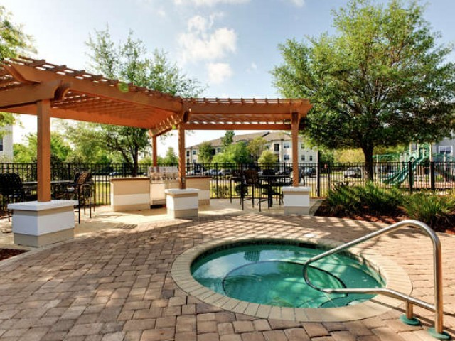 Eastport apartments spa and shaded gazebo seating area
