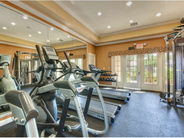 Eastport Apartments fitness center with cardio and strength training equipment