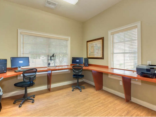 Eastport Apartments business center with computer stations and printer