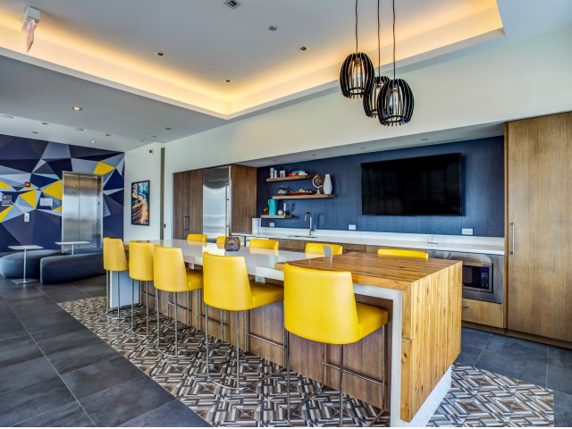 Image of Rooftop Party Room featuring a Demonstration Kitchen, Fire Place, and Panoramic Views for Mondial River West