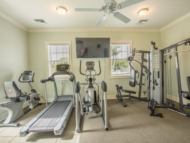 Fitness Center with stationary bike, treadmill, elliptical, and universal weight machine