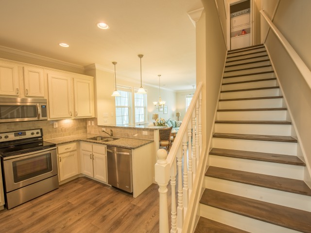 Two level home with washerdryer at top of stairs l Tarpon Harbour