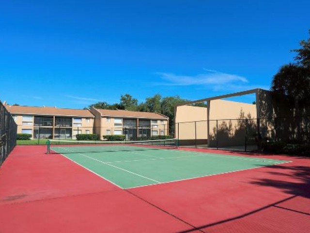 Image of Well-Lit Tennis Courts for The Park at Pienza
