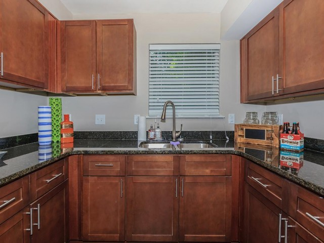 Kitchen with brown wooden cabinets
