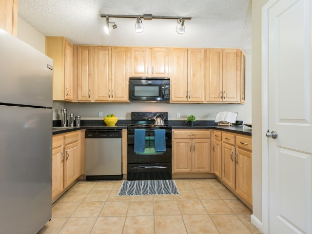 kitchen with refrigerator and wrap-around kitchen
