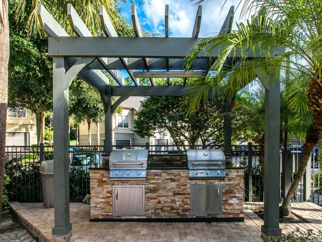 Alvista Metrowest Orlando Florida pool area grills under a pavilion