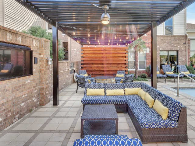 Image of Couple's Seating Poolside for Park Central at Flower Mound