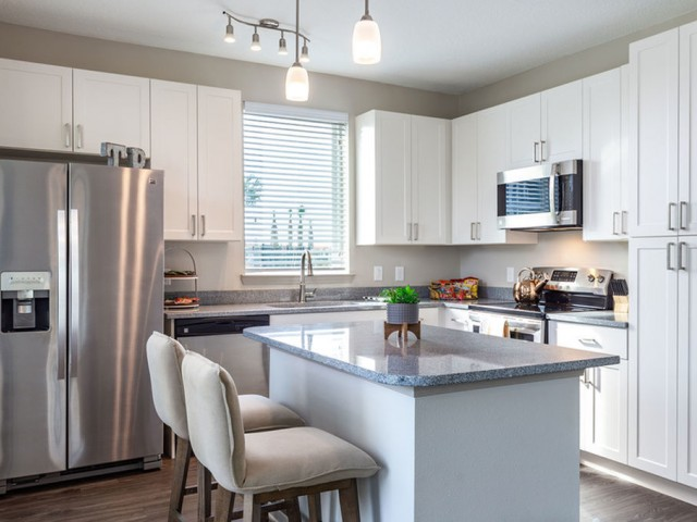 Tomoka Pointe Apartments Daytona Beach Florida model apartment home kitchen with 42