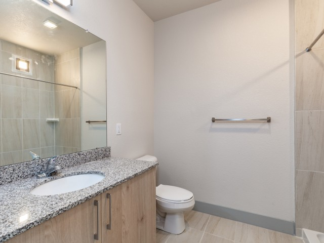 Lofts at South Lake bathroom with quartz countertop and tile surround shower walls