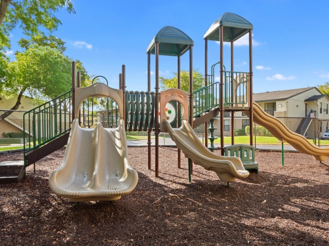 Outdoor playground with multiple slides