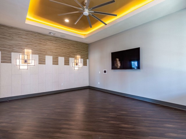 Treviso Grand Apartments - North Venice, Florida  fitness on demand open space with television