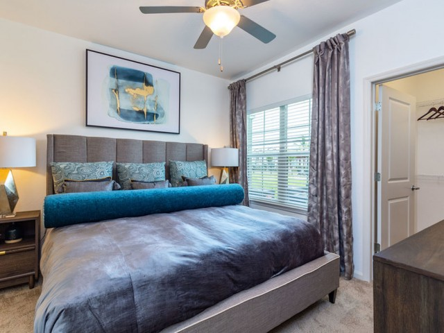 Treviso Grand Apartments - North Venice, Florida master bedroom with walk in closet and ceiling fan