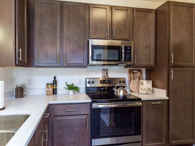 Treviso Grand Apartments - North Venice, Florida kitchen with wood shaker cabinets and stainless steel appliances