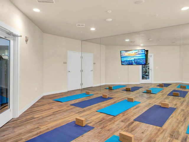 400 north apartments Maitland Florida yoga studio with mats and mirrored wall and television