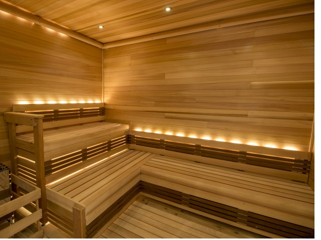 Wood plank steam room with tiered bench seating