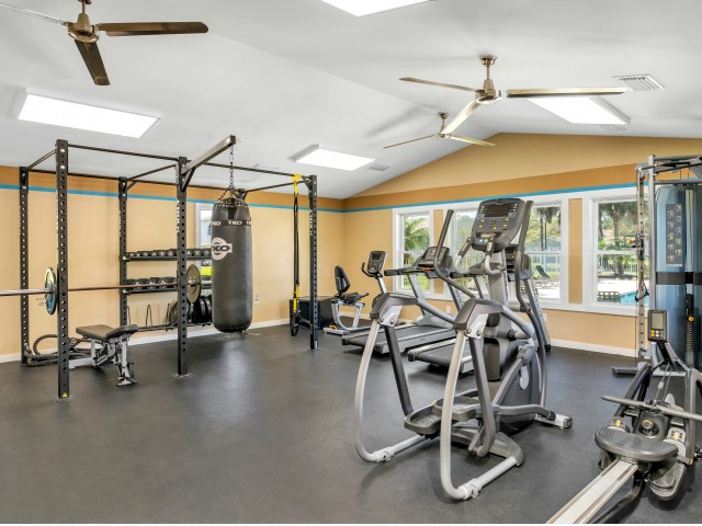 Fitness center with treadmills, stationary bike, elliptical, and various weight machines
