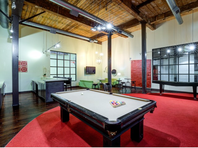 Interior view of resident lounge with billiard table and indoor shuffleboard table