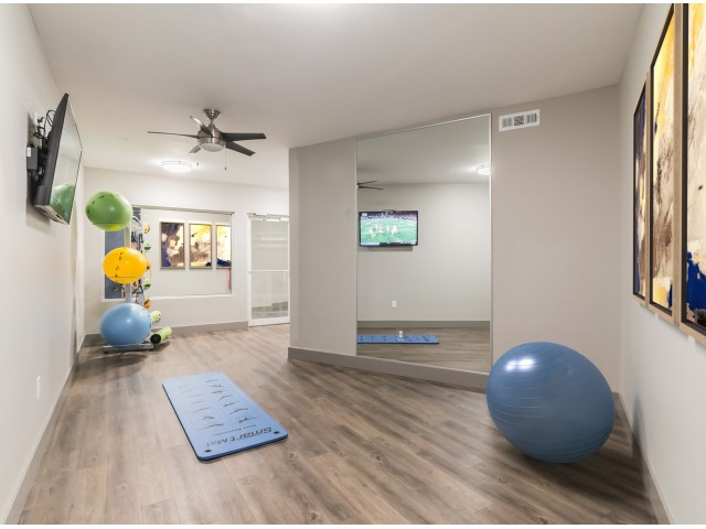 Resident fitness center with free weights and cardio equipment