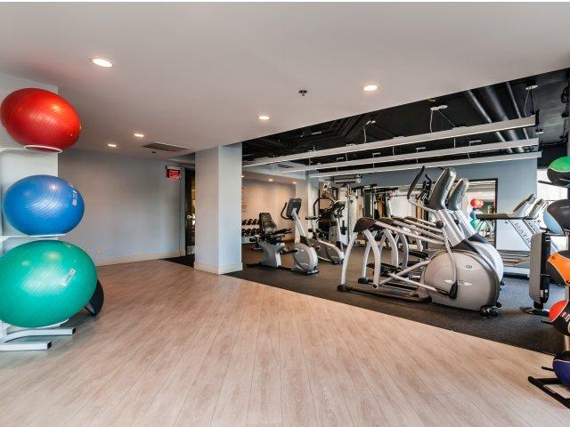 Yoga studio with adjoining fitness center