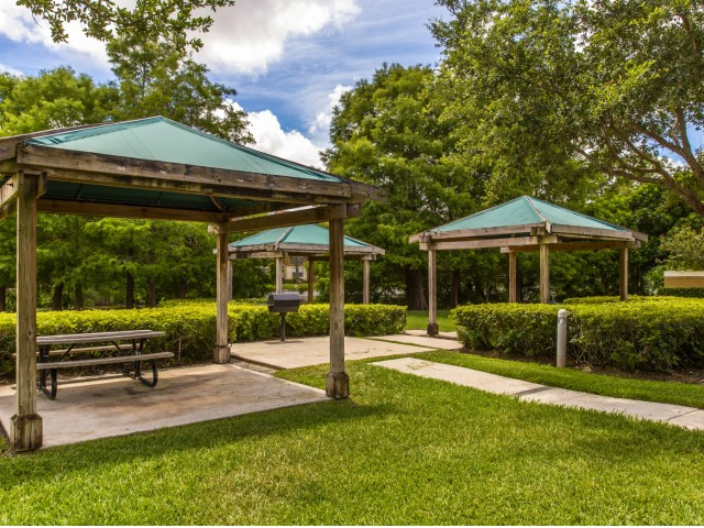 3 cabanas with bench seating, outdoor grill, walkway and landscaping