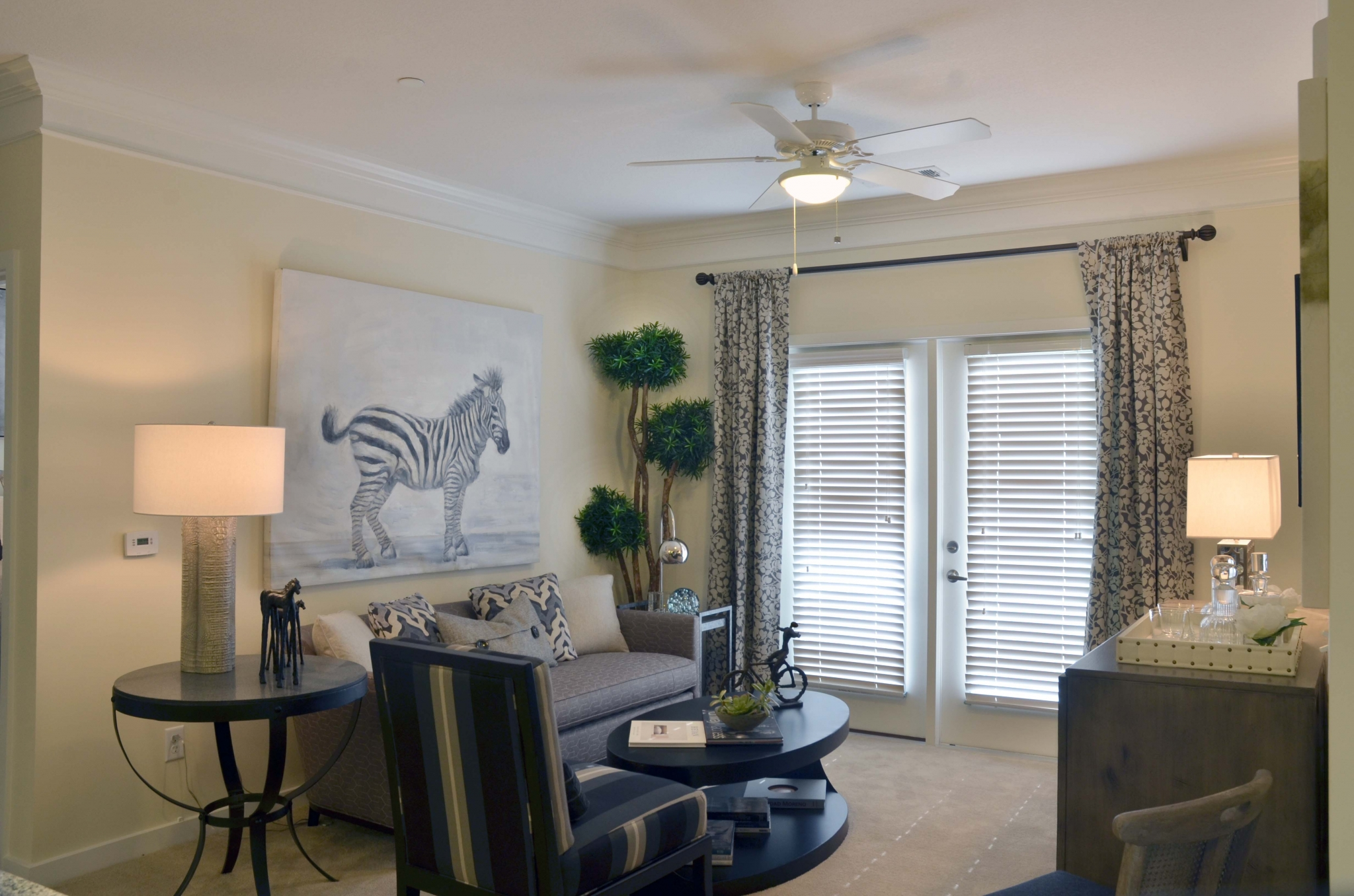 Furnished model living room showing doors to  screened in balcony