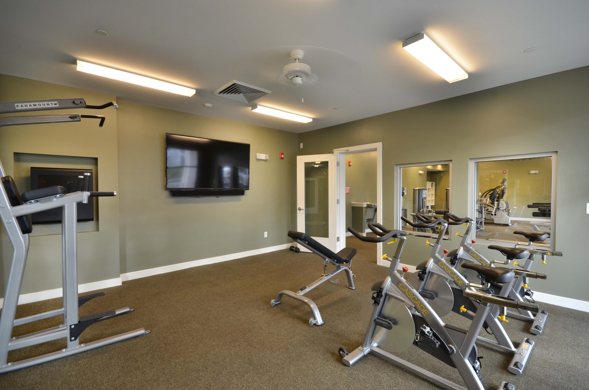 Back room of 24 hr fitness center showing bikes, fitness on demand and smith machine