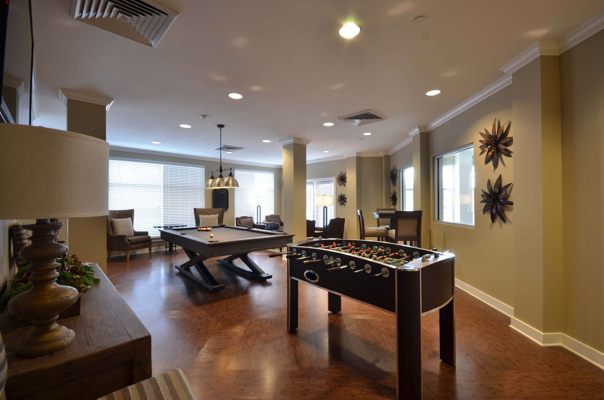 Different view of billiards room of resident lounge with foosball table