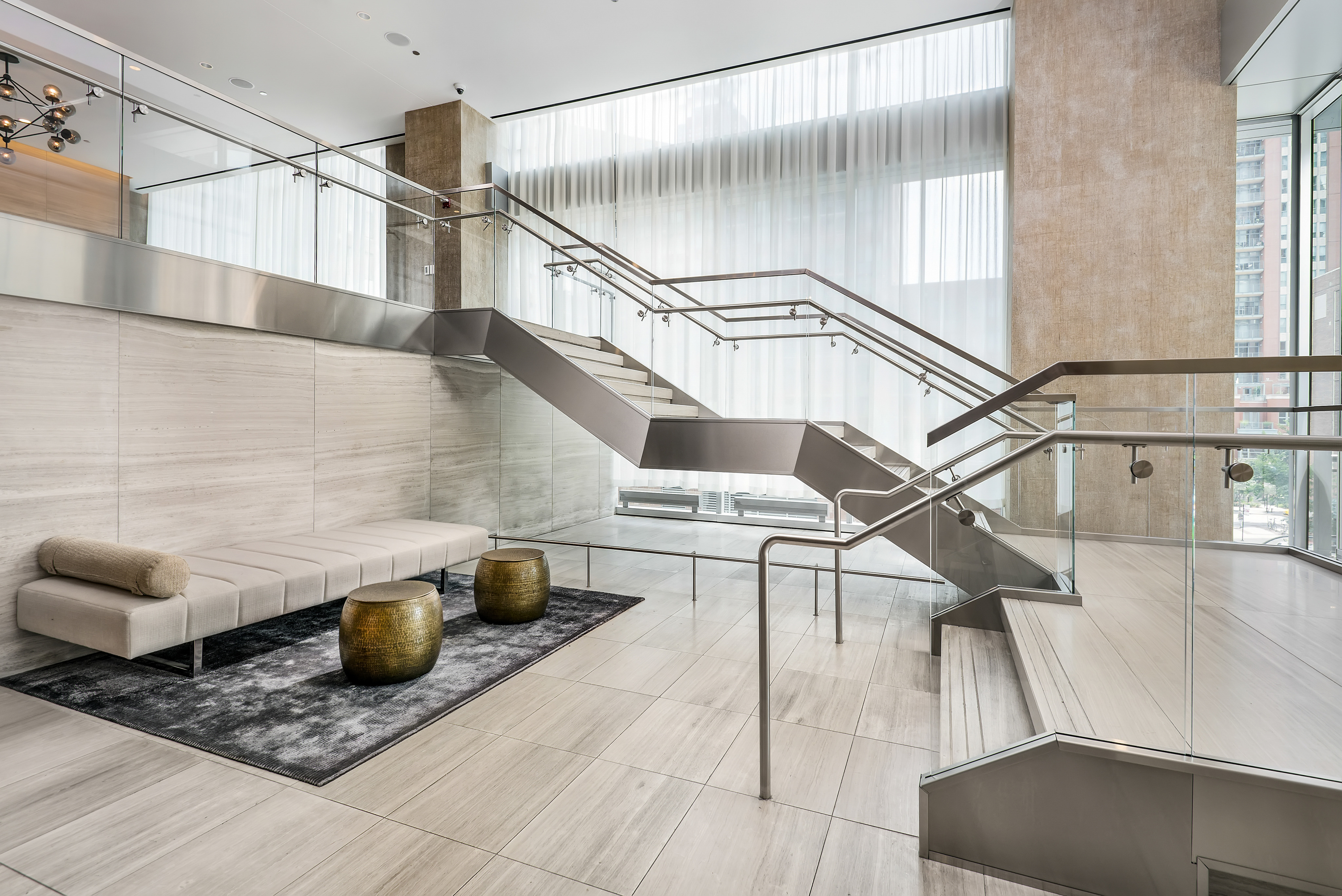 Lobby with stairs leading to a lounge area