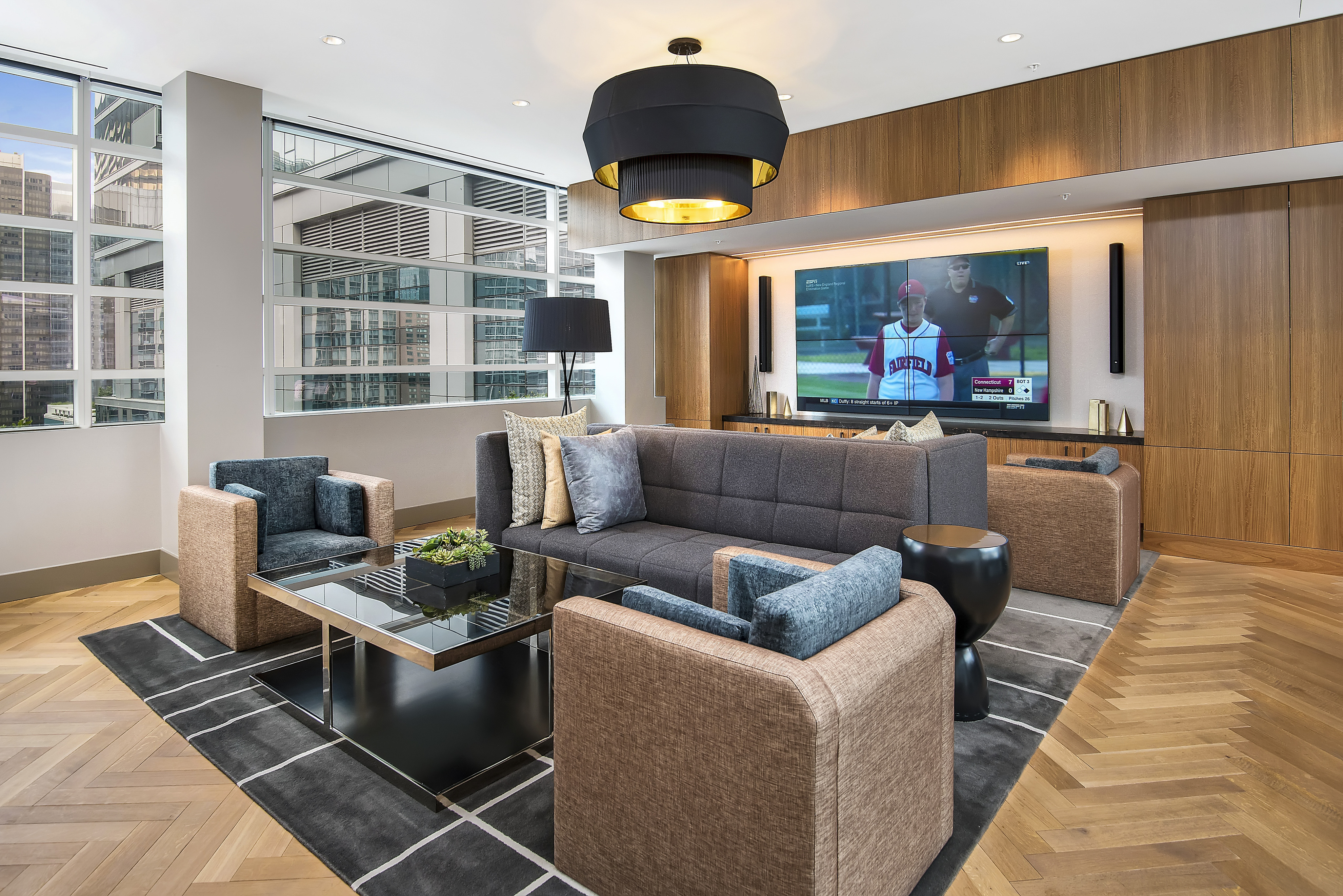 Rooftop sky lounge furnished with media wall and a city view