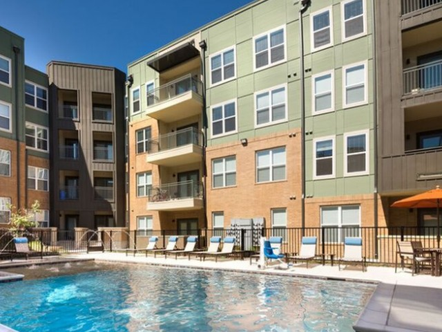 Sparkling pool with sun loungers. Smoke free apartments in Dallas | Apartments for rent in Dallas, TX | High Point Family Living | Dallas Apartments