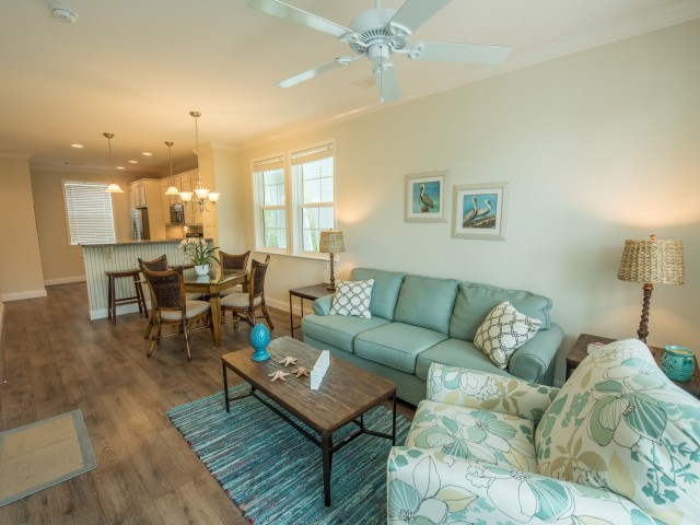 Furnished open-concept living room with ceiling fan, dining room and kitchen